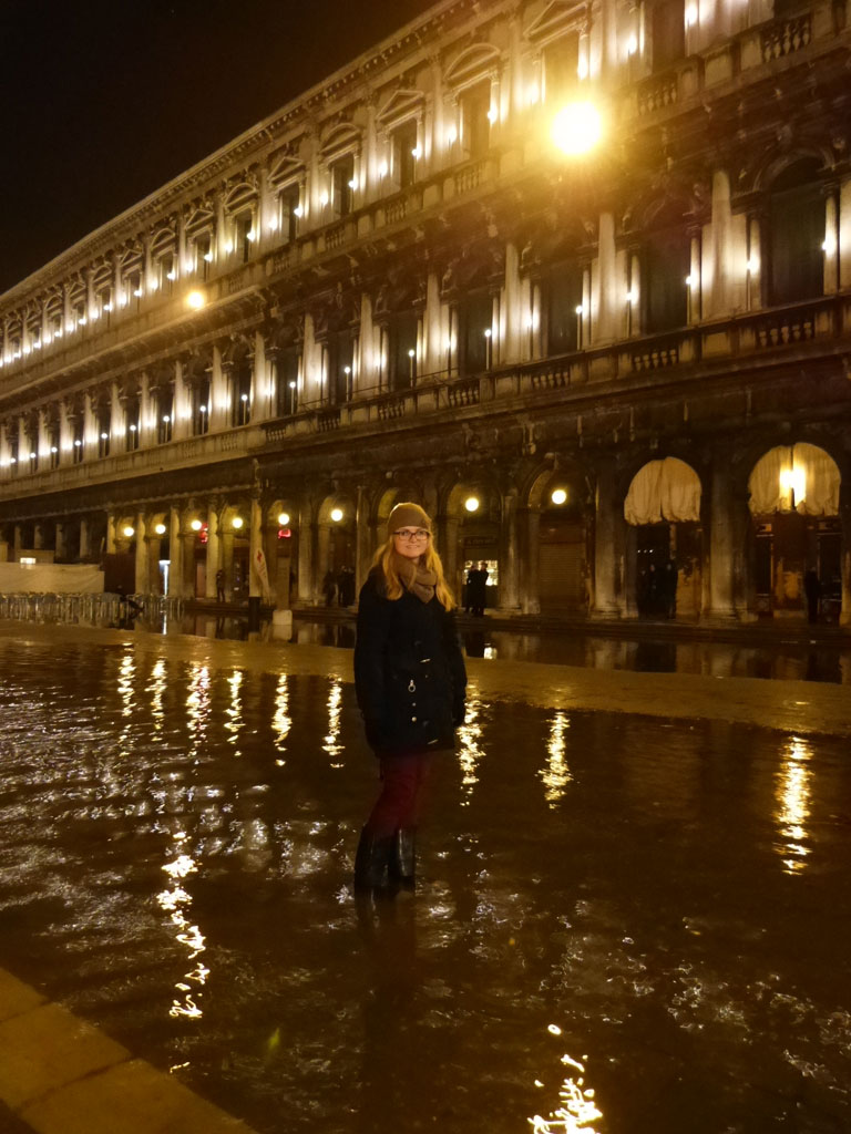 moments-of-travel-standing-in-aqua-alta-in-venice