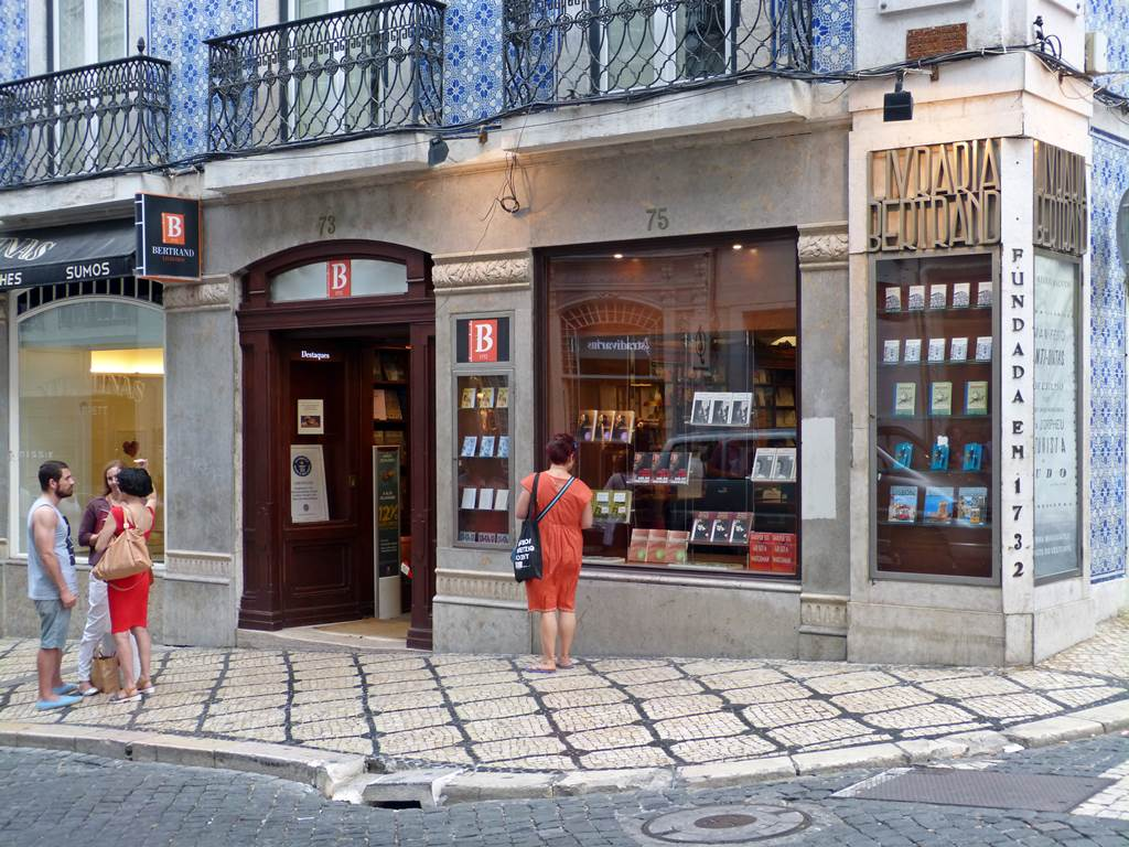 moments of travel in front of Livraria Bertrand, the oldest library in the world in Lisbon, Portugal