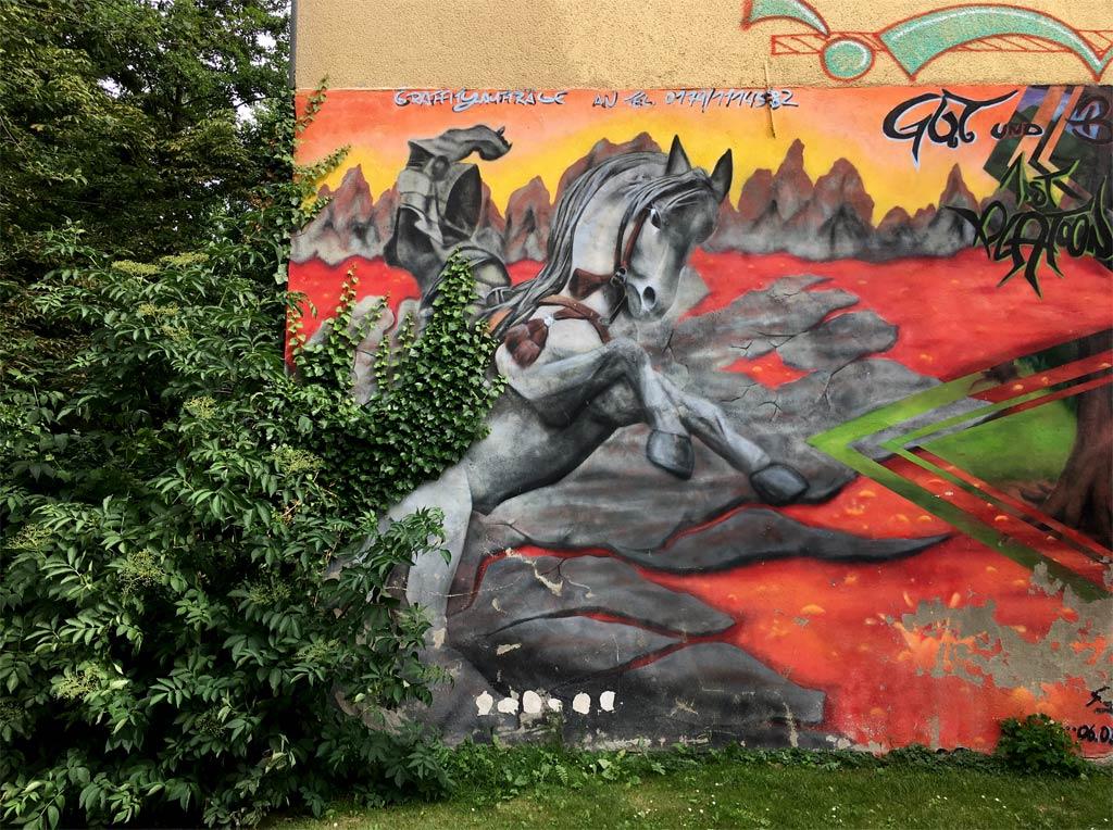 Graffitti Reiter Hauswand