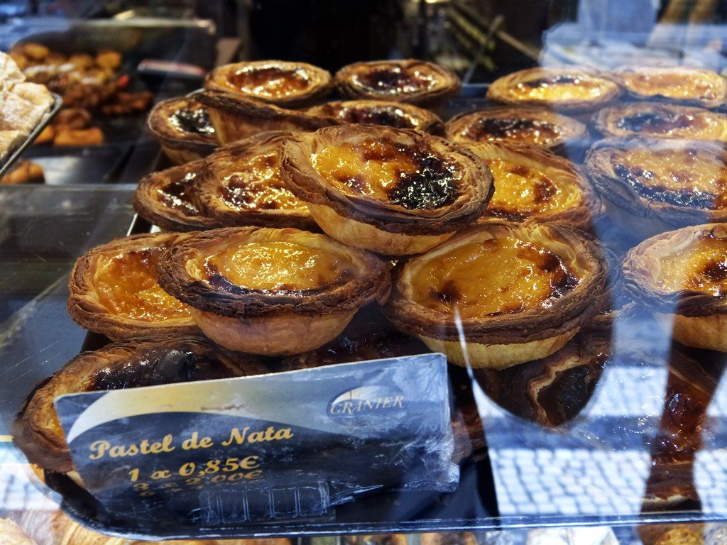 moments of travel eating Natas in Lisbon, Portugal