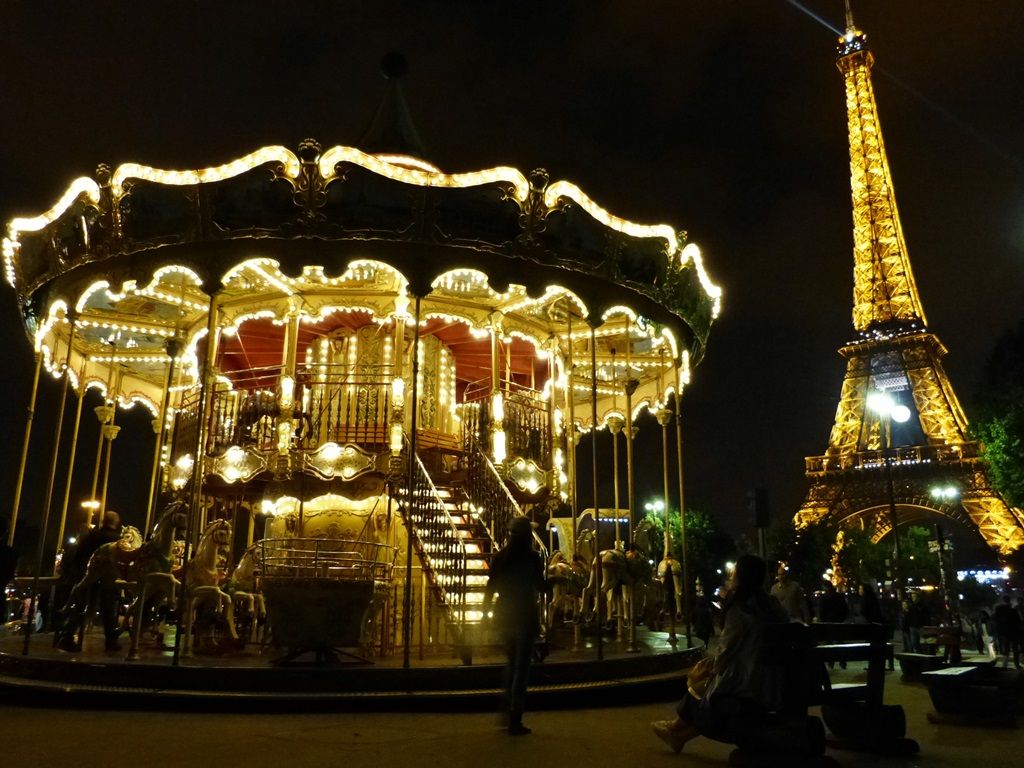 moments of travel at the Eiffel Tower at night in Paris
