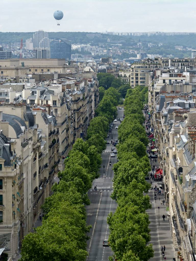 moments of travel on top of the Arc de Triomphe in Paris