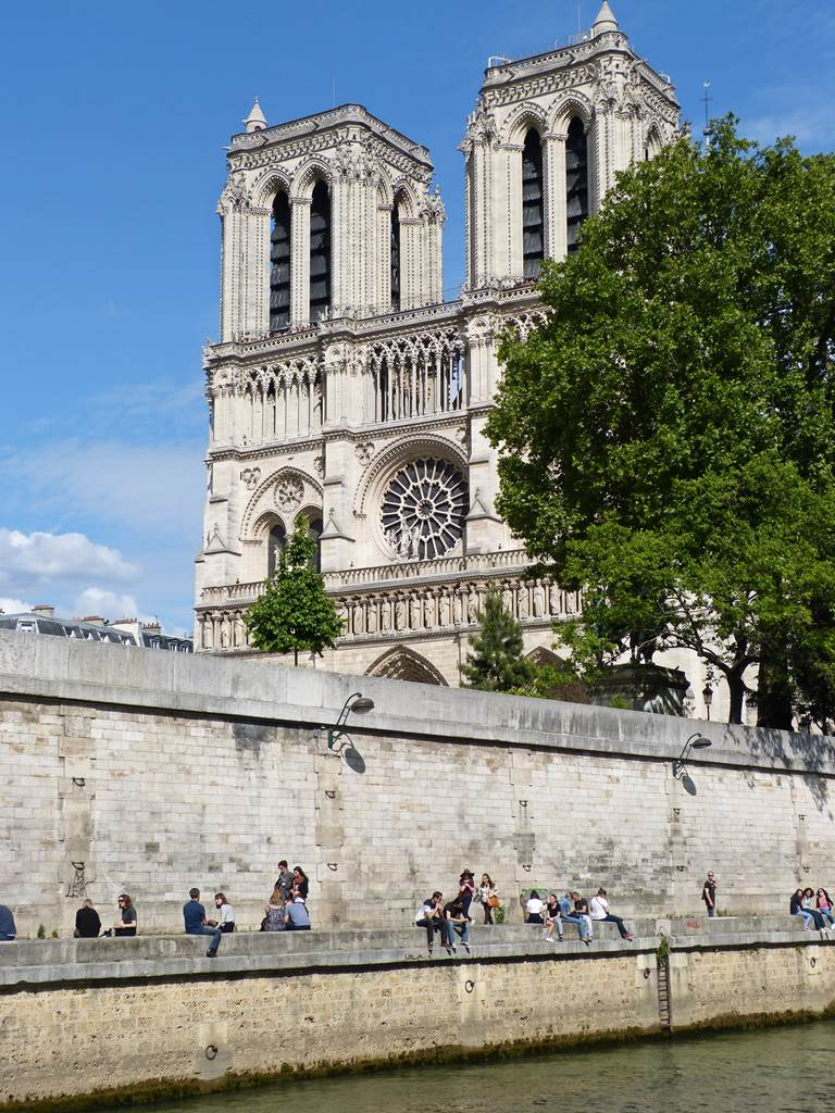 moments of travel walking along the Seine to Notre Dame in Paris
