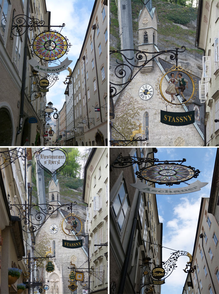 Ladenschilder und Kiche in der Getreidegasse in Salzburg